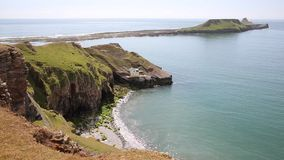 Worms Head Rhossili The Gower peninsula Wales UK PAN stock footage