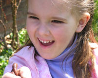 Worms are wonderful. Little girl delighted by a worm in her hand Royalty Free Stock Photo