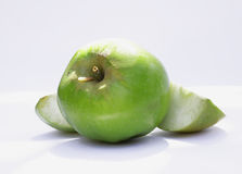 Wormy apple photo. The worm settled in a green apple which is its food. Photo for micro-stock Stock Image
