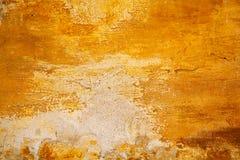 Worn желтый цвет грубой поверхности старая стена абстрактная померанцовая текстура Стоковое Фото
