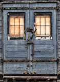 Worn abandoned railway carriage door royalty free stock image