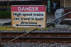 Danger high speed trains can travel in both directions sign stock image