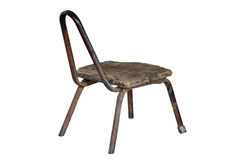 Worn aged metal chair with wooden seat Stock Images