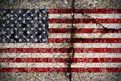 Worn American Flag on Concrete Surface. A worn and fading American flag painted on a cracked concrete surface stock illustration