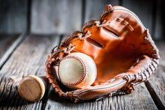 Worn Baseball ball and glove Stock Photos