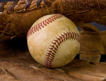 Worn baseball and old glove Royalty Free Stock Images