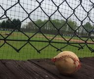 Worn baseball on wooden deck royalty free stock photo