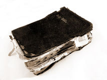 Worn Bible. In Sepia tinted black and white isolated on white background royalty free stock photos