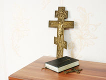 Worn bible with two bronze crosses Stock Photo