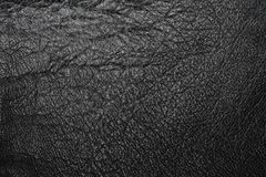 Worn black leather. Worn and cracked black leather texture Royalty Free Stock Photos
