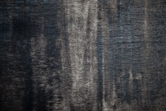 Worn black painted plywood. Royalty Free Stock Photo