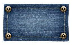 Worn blue denim jeans tag Stock Image