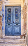 Worn blue door Stock Photos