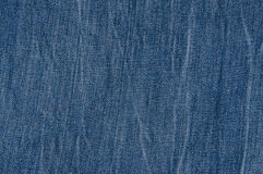 Worn Blue Jeans. Texture of worn blue jeans large Stock Images