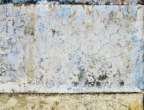 Worn blue paint texture in old stone wall. Royalty Free Stock Photography