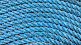 Worn blue rope. Old worn blue rope can be used as background or wallpaper and for other possibility to modify to your taste Stock Photo