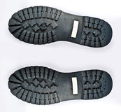 Worn Boot Soles. A couple of worn classic boot soles royalty free stock photography