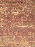 Worn brick II. Color photo of old brick building with worn and peeling paint on red bricks royalty free stock photography