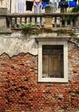 Worn brick wall and washing Stock Photo