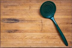 Worn Butcher Block Cutting Board with Ladle Royalty Free Stock Photos
