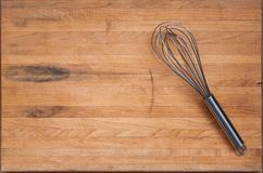 Worn Butcher Block Cutting Board with Whisk Stock Photo