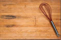Worn Butcher Block Cutting Board with Wire Whisk Stock Photography