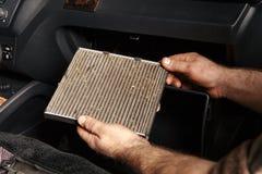 Worn cabin air conditioner filter of car. Worn cabin air conditioner filter Royalty Free Stock Photos