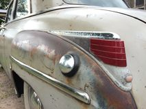 Worn car. Back of old rusty american car Royalty Free Stock Photo