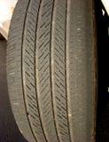 Worn Car Tire with Irregular Used Bald Low Thread stock photo