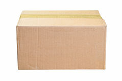 Worn Cardboard Box. Closed and Taped Brown Cardboard Box for Copy Stock Photos