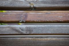 Worn and Carved Wooden Park Bench, Background Texture royalty free stock images