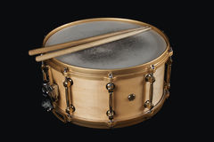 Worn copper snare drum with drumsticks Stock Photography
