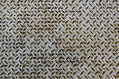 Worn diamond plate metal with rust Royalty Free Stock Photos