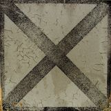 Worn dirty black on white painted cross Royalty Free Stock Photography