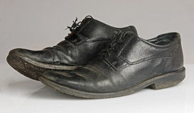 Worn and dirty blackshoes Royalty Free Stock Photo
