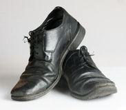 Worn and dirty blackshoes Royalty Free Stock Images