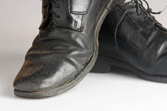 Worn and dirty blackshoes Stock Photo