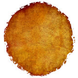 Worn and distressed leather drum head. Frayed and distressed brown leather disc Royalty Free Stock Photos