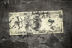 Worn 100 dollar note. An image of a grunge wall with a worn 100 dollar note Stock Photos