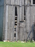 Worn down barn wall. A picture of a wooden barn, with its wall worn out and missing a few planks Stock Photography