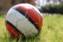 Worn down soccer ball Royalty Free Stock Photography