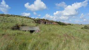 Worn down war bunkers in the dunes stock photos
