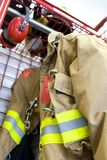 Worn fireman coat. A worn fireman coat awaits the next call Stock Image