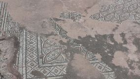 Worn floor mosaic, St Paul's Pillar, Paphos stock image