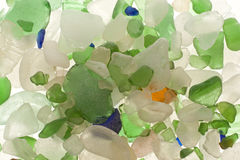 Worn glass. Shards of glass worn by the waves and the rocks on a beach Royalty Free Stock Image