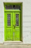 Worn green door Royalty Free Stock Images