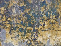 Worn grunge blue green and yellow wall Stock Image