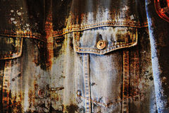 Worn grunge blue jeans background Stock Photos