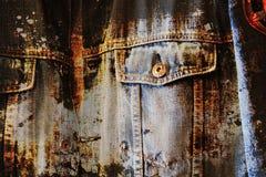 Worn grunge blue jeans background Stock Photos