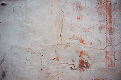 Worn grunge wall with stucco and crack Stock Images